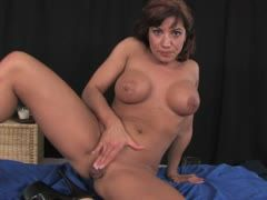 Brunette fucks herself with vibrator